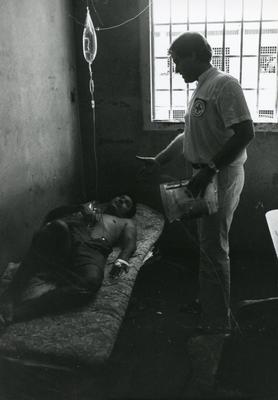 Black and white photograph of ICRC delegates visiting POW's in Nicaragua