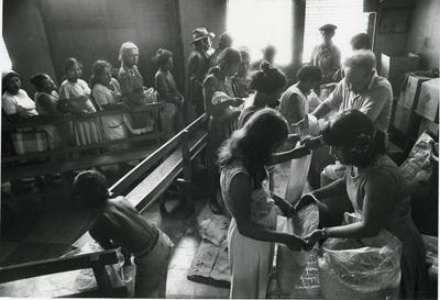 Black and white photograph of displaced people in El Salvador