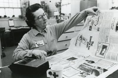 Black and white photograph for World Red Cross Day 1981 - American Red Cross volunteer in New Jersey records the local news on tape for the visually impaired