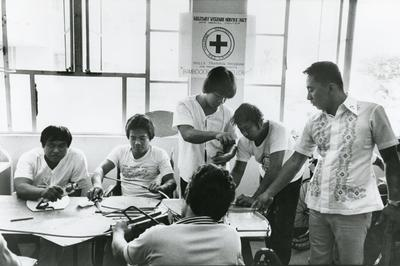 Black and white photograph for World Red Cross Day 1981 - Philippines Red Cross providing occupational therapy in an armed forces hospital