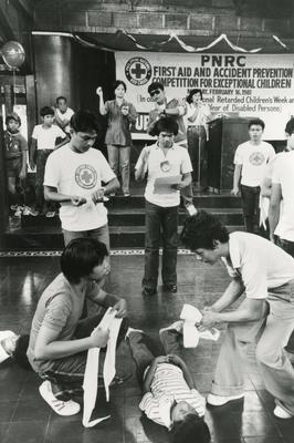 Black and white photograph for World Red Cross Day 1981 - Philippines Red Cross organising a series of First Aid training sessions and competitions