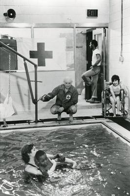 Black and white photograph for World Red Cross Day 1981 - American Red Cross teaching disabled children to swim at the Kennedy School in New Jersey