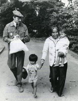 Black and white photograph for World Red Cross Day 1980 - Vietnamese refugees being resettled in Paris by the French Red Cross during 1979