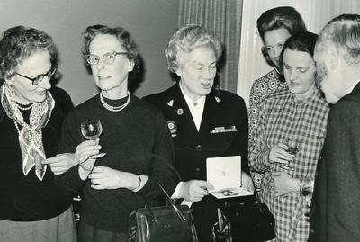 Black and white photograph of Miss B Wade after receiving her OBE