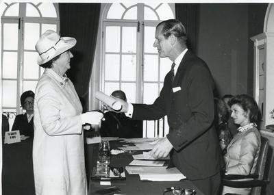Black and white photograph of the Duke of Edinburgh presenting the Florence Nightingale Medal to Gwyneth Ceris Jones July 1971