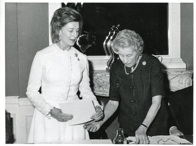 Black and white photograph of the Countess of Limerick awarding HRH Princess Alexandra with the Class I Certificate of Honour and badge