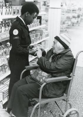 Black and white photograph of Youth and Juniors helping people with their Christmas shopping
