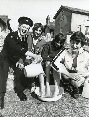 Black and white photograph of a sponsored walk during Red Cross Week 1976