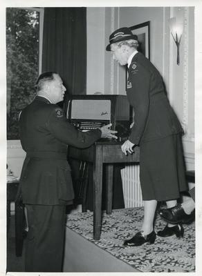 Black and white photograph of Major General L A Hawes with the Princess Royal on the occasion of his retirement from his role of Controller of the Home Department