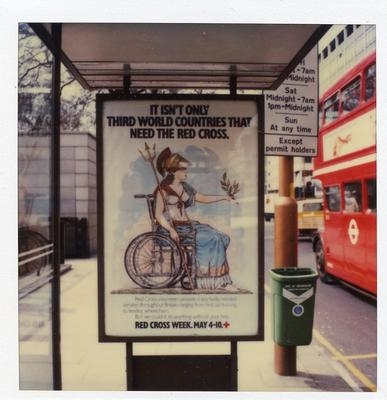 Colour photograph of a Red Cross poster advertising Red Cross Week at a central London bus stop