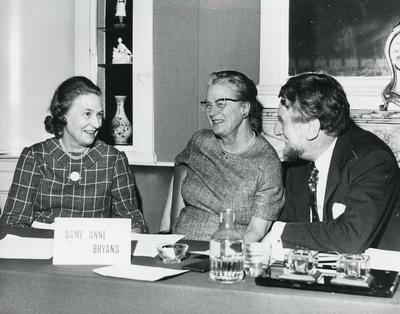 Black and white photograph of Mrs William Whitelaw, Dame Anne Bryans and Sir Evelyn Shuckborough at an Executive Meeting at NHQ