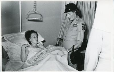 Black and white photograph of Lady Mountbatten on tour of a British Military Hospital in Tripoli