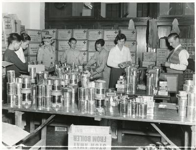 Black and white photograph of preparing prisoner of war parcels in Hong Kong 1950s