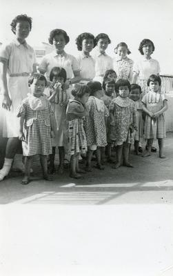Black and white photograph of Junior Link helping look after children in the Ling Yuet Sin Hospital