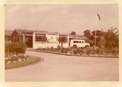 Colour photograph of a Red Cross building in Kluang, Malaya