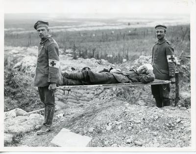 Black and white photograph of a German stretcher bearer with a British casualty during the First World War