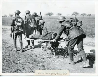 Black and white photograph of a pram being used as a stretcher at the Somme during the First World War