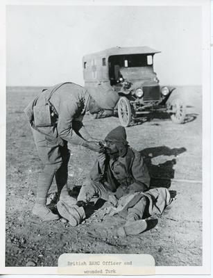 Black and white photograph of a British RAMC officer and a wounded Turkish soldier during the First World War