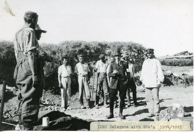 Black and white photograph of an ICRC delegate visiting prisoners of war during the First World War
