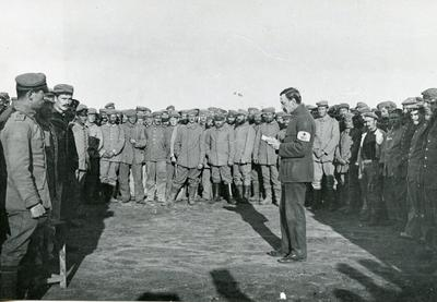 Black and white photograph of an ICRC delegate visiting German prisoners of war during the First World War
