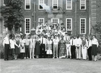 Black and white photograph of delegates attending the British Red Cross Youth Jubilee International Youth meeting, 26 July 1984