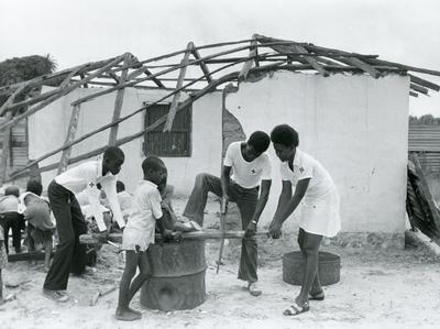 Black and white photograph of young volunteers of the Gambia branch
