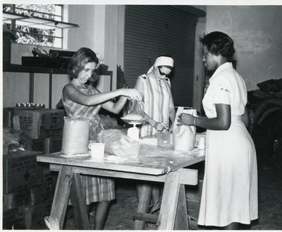 Black and white photograph of the disaster relief store at the Jamaican Red Cross