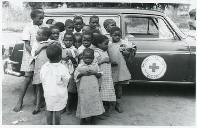 Black and white photograph of Malawi children with clothes from the British and Canadian Red Cross