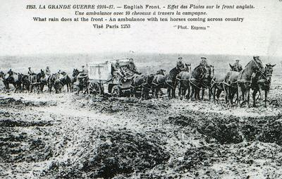 Black and white photograph of a postcard showing a horsedrawn ambulance at the English Front during the First World War