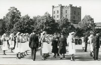 Black and white photograph of the presentation of an ambulance during a visit from the Princess Royal in Durham