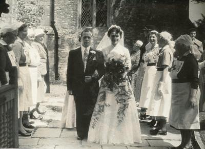 Black and white photograph of a Red Cross guard of honour at a wedding in the Hampshire, Surrey and Isle of Wight area