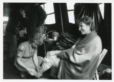 Black and white photograph of first aid assistance at Chichester Military March