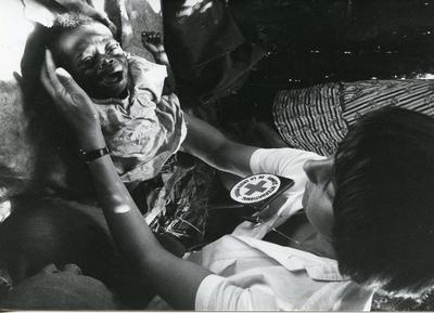Black and white photograph of Red Cross assistance in Angola