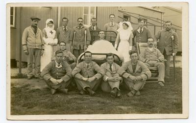 Hospital Staff and patients outside Hut 24; 0324/IN7159
