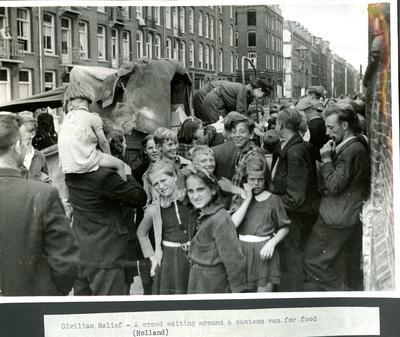 Photograph showing refugees waiting at a mobile canteen in Holland during the Second World War; Audiovisual/photograph; JWO/9/3/2b