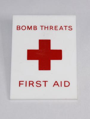 Plastic badge: Bomb Threats, First Aid