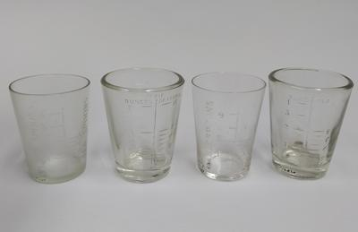 Four glass measuring beakers
