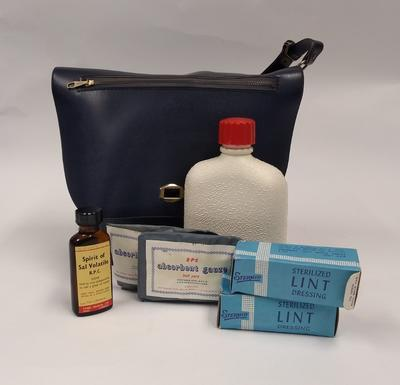 First Aid kit in navy blue plastic shoulder bag