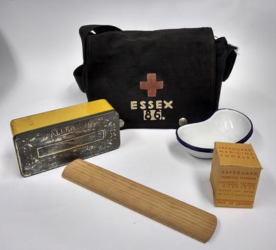 First aid kit in black canvas bag with 'Essex 86' the Red Cross emblem