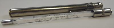 Glass thermometer contained in metal tube
