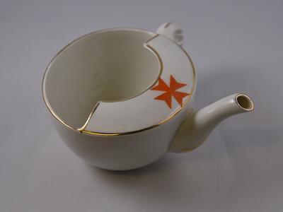 White ceramic feeding cup in original packaging