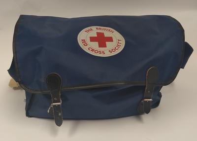 Navy, nylon shoulder bag containing First aid kit.