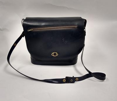 Navy blue plastic shoulder bag with an adjustable strap
