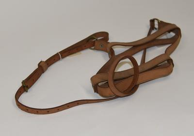Leather bottle carrier.