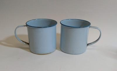 Two large blue enamel mugs