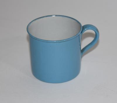 Two small enamel mugs