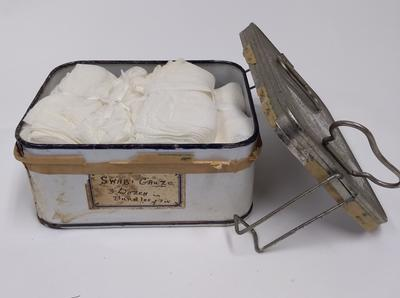 Tin containing six gauze swabs