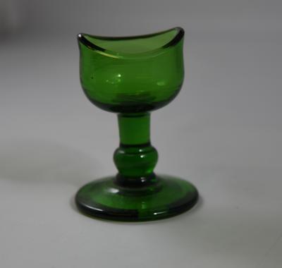 Green glass eye bath with stem