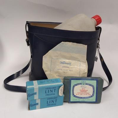 First Aid kit in navy blue plastic shoulder bag