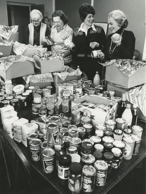 Members of the Norfolk Branch of the British Red Cross preparing Food Parcels